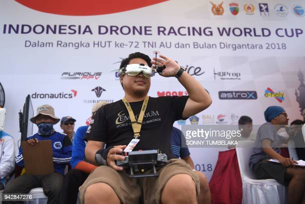 A pilot holds his drone as he prepares to race during the FAI Drone Racing World Cup event in Denpasar on Indonesia's resort island of Bali on April...