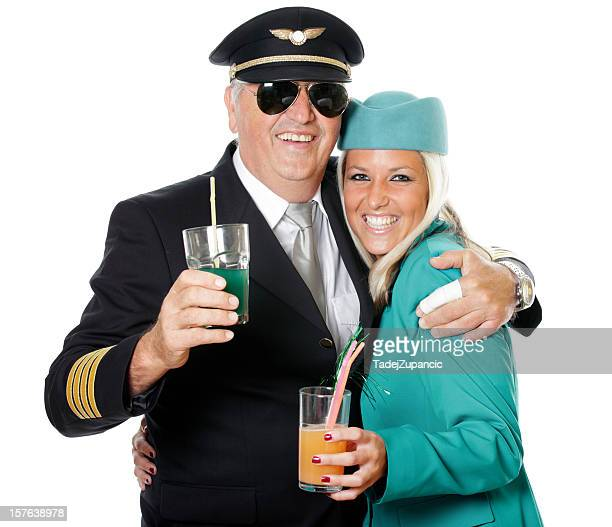 pilot hugging the stewardess - aviation hat stock photos and pictures