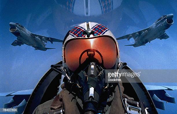 Pilot in cockpit of jet