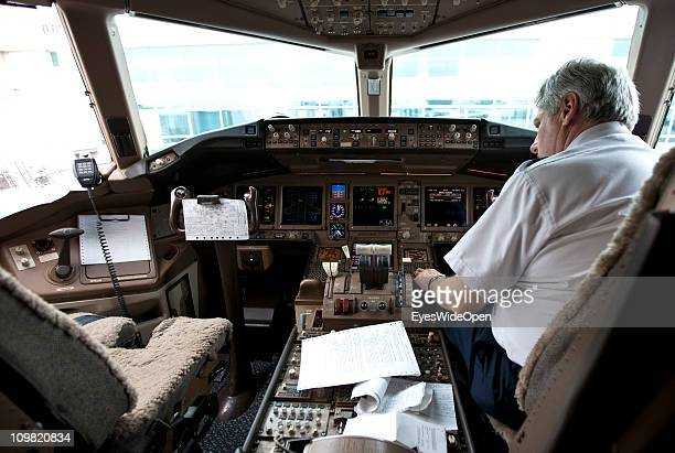 Pilot in the cockpit of a Boeing 777 at Denver International Airport on February 05 2011 in Vail Colorado United States