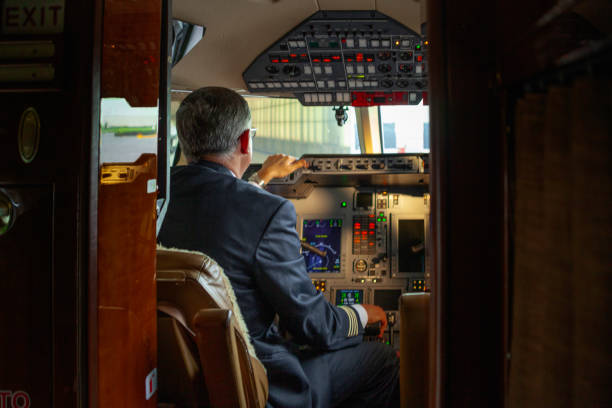 A pilot inside a cabin of a plane starting the plane