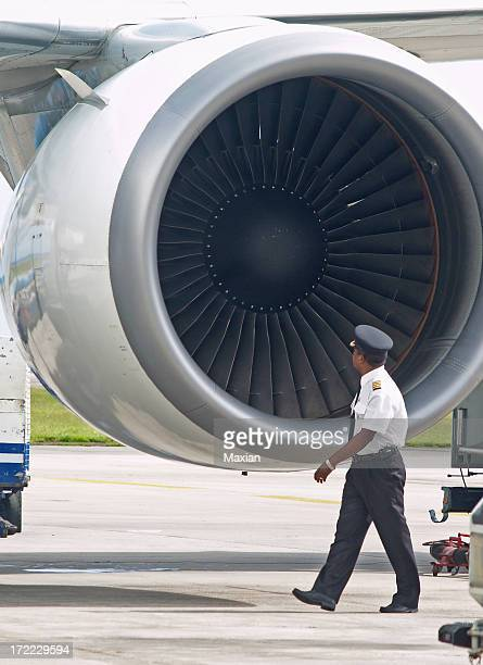 A pilot inspecting a plane before slight