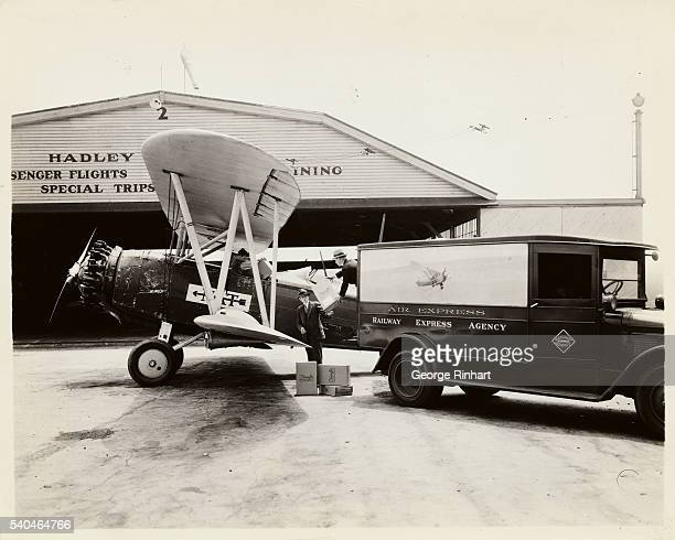 Pilot is loading airmail boxes into plane