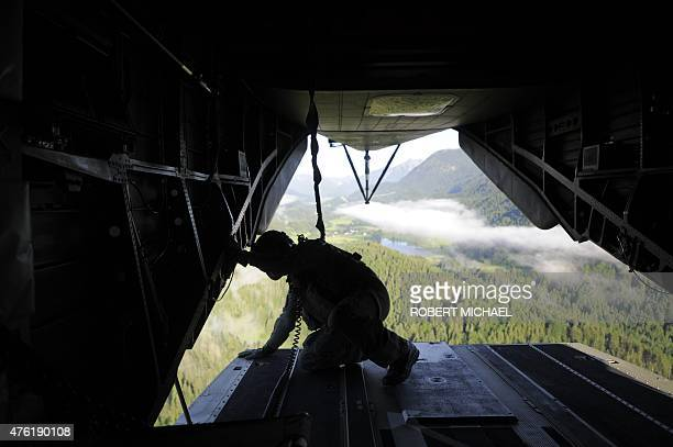 Pilot is pictured inside a helicopter of the German Armed Forces Bundeswehr on its way to Kruen near Garmisch-Partenkirchen, southern Germany on June...