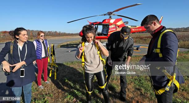 Pilot Jeff Hubbard second from right of Hover Boston prepares passengers Rachel Leiner far left Caila Quinn center and Nick Burrello far right for a...