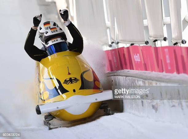 TOPSHOT Pilot Johannes Lochner of Germany leads his team as they cross the finish line in the 4man bobsleigh training during the Pyeongchang 2018...
