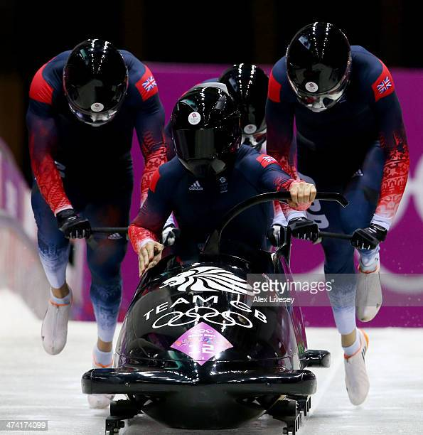 Pilot John James Jackson Stuart Benson Bruce Tasker and Joel Fearon of Great Britain team 1 make a run during the Men's Four Man Bobsleigh heats on...