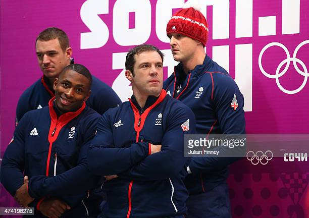 Pilot John James Jackson Stuart Benson Bruce Tasker and Joel Fearon of Great Britain team 1 look on after a run during the Men's Four Man Bobsleigh...