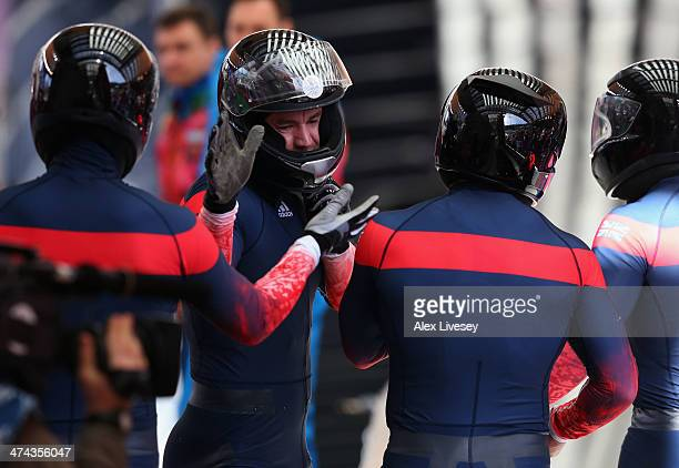 Pilot John James Jackson Stuart Benson Bruce Tasker and Joel Fearon of Great Britain team 1 look on after a run during the Men's FourMan Bobsleigh on...