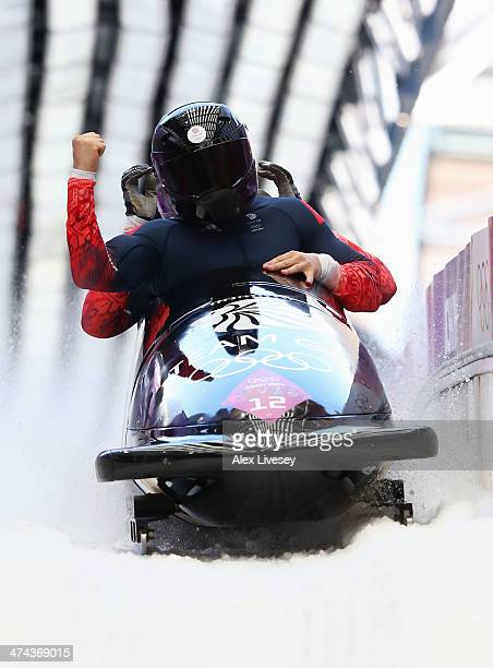 Pilot John James Jackson Stuart Benson Bruce Tasker and Joel Fearon of Great Britain team 1 finish a run during the Men's FourMan Bobsleigh on Day 16...