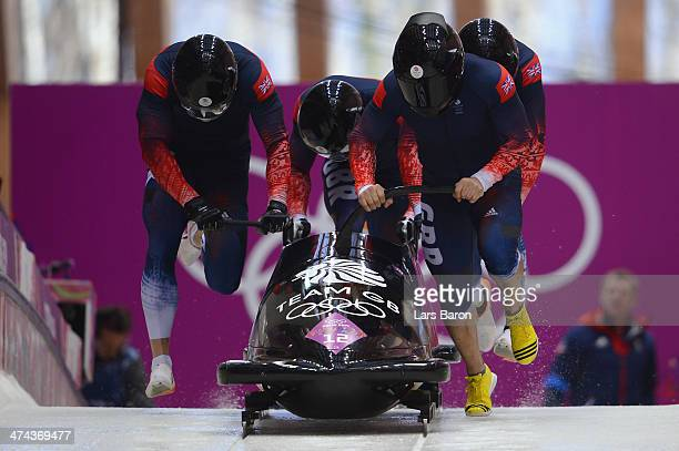 Pilot John James Jackson Stuart Benson Bruce Tasker and Joel Fearon of Great Britain team 1 make a run during the Men's FourMan Bobsleigh on Day 16...