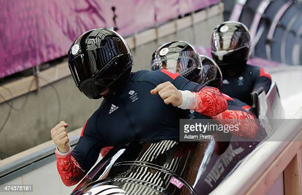 Pilot John James Jackson Stuart Benson Bruce Tasker and Joel Fearon of Great Britain team 1 react after a run during the Men's FourMan Bobsleigh on...