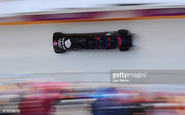 Pilot John James Jackson Stuart Benson Bruce Tasker and Joel Fearon of Great Britain team 1 make a run during the Men's Four Man Bobsleigh on day 16...