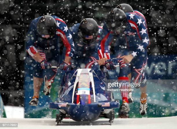 Pilot John Napier , Charles Berkeley, Steven Langton and Christopher Fogt of the United States compete in USA 2 during the four-man bobsleigh heat 1...