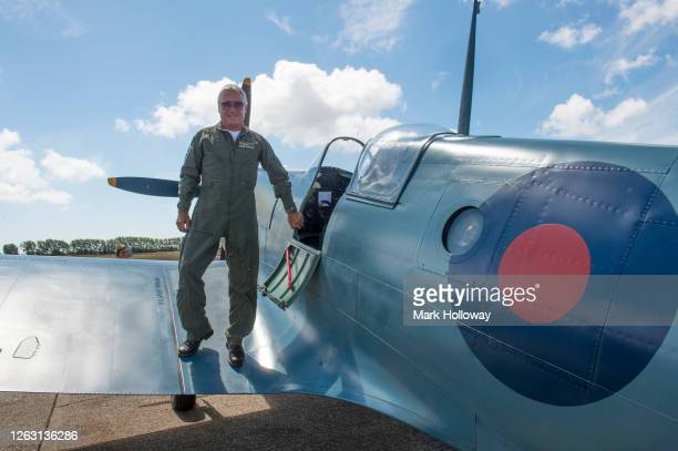 Pilot John Romain standing on the wing of the 'Thank U NHS' Spitfire at Goodwood on August 01 2020 in Chichester England The 'Thank U NHS' Spitfire...