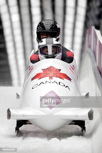 Pilot Justin Kripps and Bryan Barnett of Canada team 3 finish a run during the Men's TwoMan Bobsleigh on Day 10 of the Sochi 2014 Winter Olympics at...