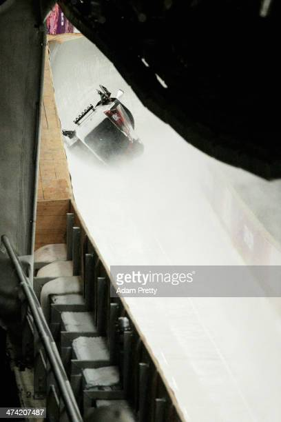 Pilot Justin Kripps Jesse Lumsden Cody Sorensen and Ben Coakwell of Canada team 3 crash while competing during the Men's Four Man Bobsleigh heats on...