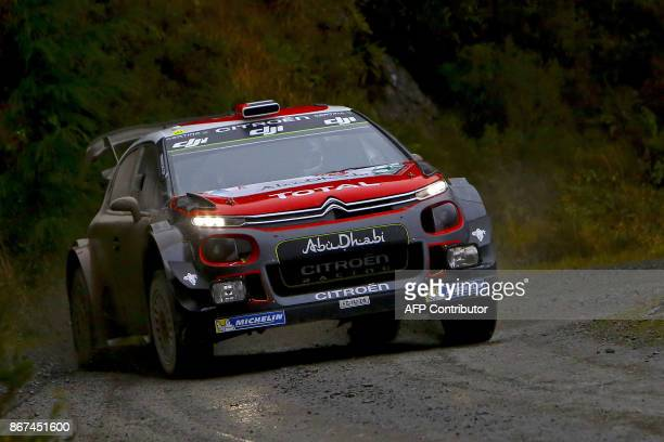 UAE pilot Khalid Al Qassimi and co pilot Chris Patterson of Citroen Total Abu Dhabi WRT compete in their Citroen C3 WRC during special stage 11 of...