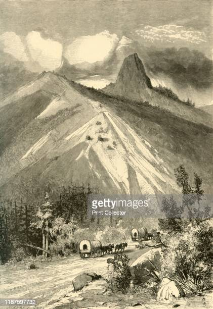 Pilot Knob' 1872 Covered wagons travelling west past Pilot Rock a volcanic plug in Oregon USA 'one sees rising in the blue air the singular form of...