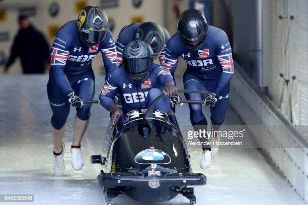 Pilot Lamin Dean of Great Britain competes with Ben Simons John Baines and Andrew Matthews during the first run of the IBSF World Championships Bob...
