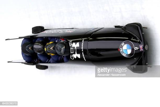 Pilot Lamin Deen of Great Britain competes with Ben Simons John Baines and Andrew Matthews at the third run of the IBSF World Championships Bob...
