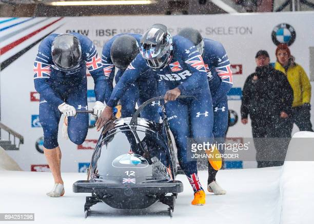 Pilot Lamin Deen with Ben Simons Bruce Tasker and Joel Fearon of Great Britain compete during the first run of the fourman Bobsleigh event within the...