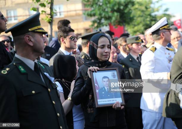 Pilot Lieutenant Nuri Sener's wife Melike Sener attends the funeral ceremony held for Pilot Lieutenant Nuri Sener who was martyred in a helicopter...