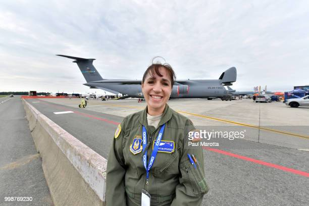 Pilot Major Susan McSpadden is seen with a Galaxy C5M transport plane at the 2018 Great New England Air and Space Show on July 14 2018 in Chicopee...