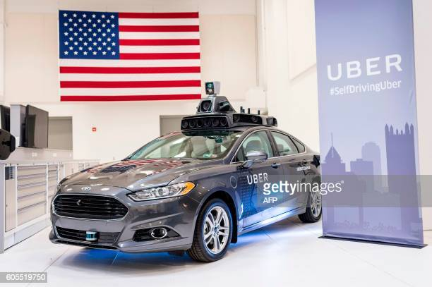 A pilot model Uber selfdriving car is displayed at the Uber Advanced Technologies Center on September 13 2016 in Pittsburgh Pennsylvania Uber...