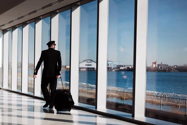 DC: Travelers Move Through LaGuardia Airport As Pandemic Continues