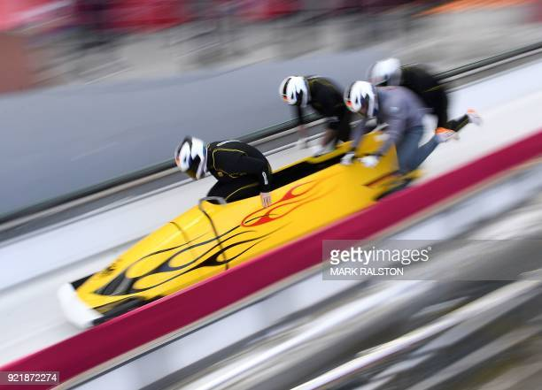 TOPSHOT Pilot Nico Walther of Germany leads his team at the start of the 4man bobsleigh training session during the Pyeongchang 2018 Winter Olympic...