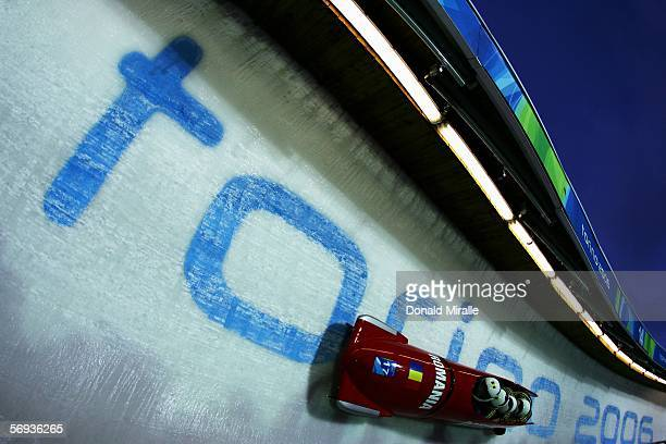 Pilot Nicolae Istrate and teammates Adrian Duminicel Gabriel Popa and Ioan Danut Dovalciuc of Romania 1 compete in the Four Man Bobsleigh Final on...