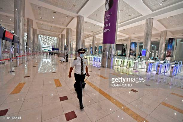 Pilot of an Emirates Airlines flight from London arrives at Dubai International Airport on May 8, 2020 amid the coronavirus Covid-19 pandemic.