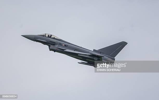 A pilot of an Eurofighter Typhoon plane of the Austrian Airforce performs during the Airshow Airpower 16 on September 2 in Zeltweg Austria / AFP /...