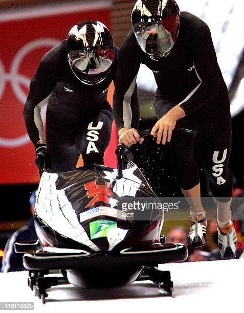 Pilot of bobsled Team USA1 Todd Hayes and brake man Pavle Jovanovic begin begin their second run in the Men's 2Man Bobsled competition at Cesana...