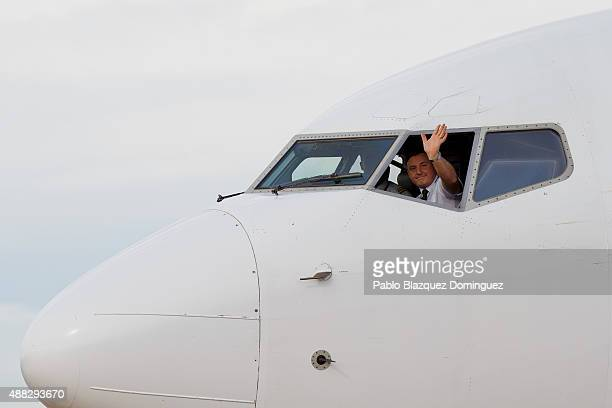 Pilot of the first commercial flight at Castellon airport waves after landing on September 15 2015 near Castellon de la Plana in Castellon province...