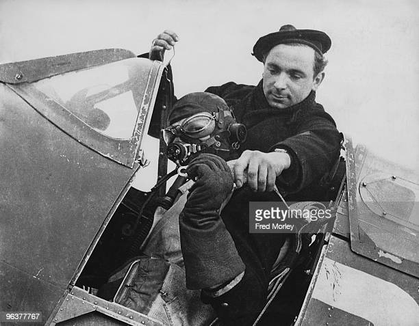 Pilot of the Free French Air Force in the cockpit of his Spitfire fighter, 15th January 1942.