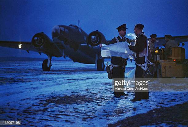 A pilot of the Royal Canadian Air Force preparing for a night flight from a training centre in Canada circa 1940