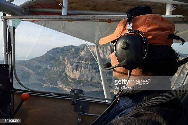 pilot of ultralight plane flying over calanques - aereo ultraleggero foto e immagini stock