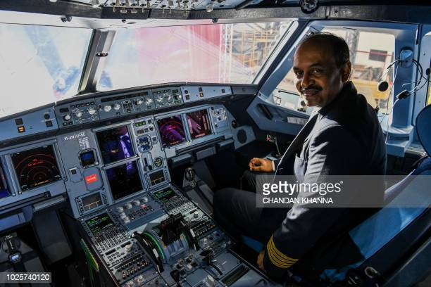 Pilot of Vistara's new Airbus A320neo pose during an event at the Indira Gandhi International Airport in New Delhi on September 1 2018...