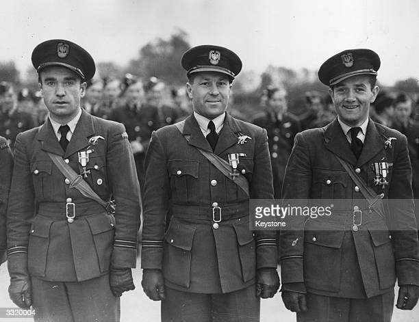 Three Polish fighter pilots who received decorations from the Polish premier in exile General Sikorski for their services to a Polish wing of the RAF...