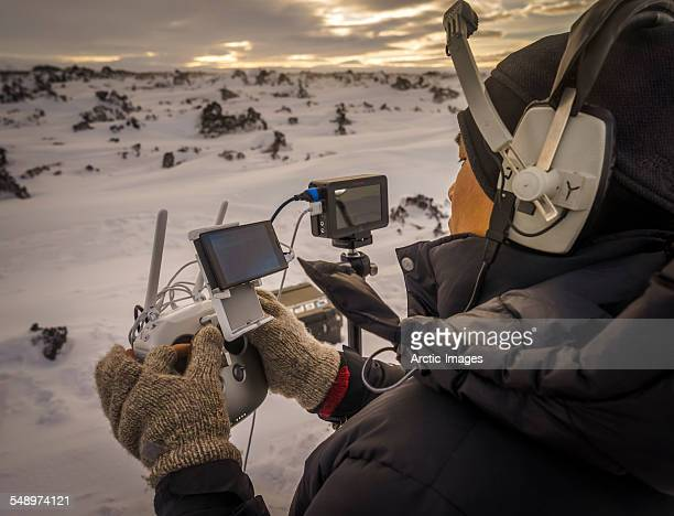 Pilot operating a drone with a camera, Iceland