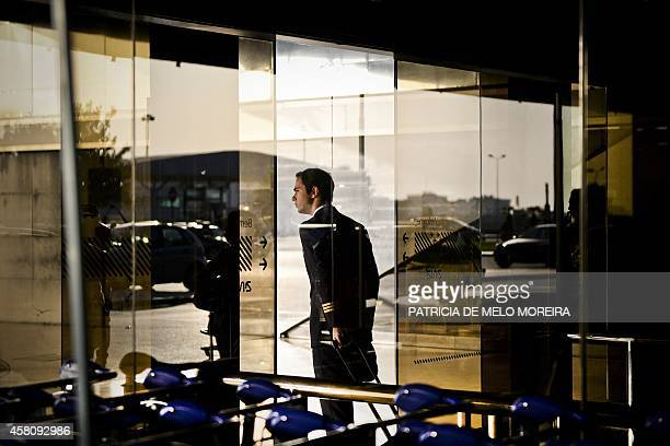 A TAP pilot pass through the Lisbon's Airport doors during a strike by Portugese airline TAP on October 30 2014 Air traffic was disrupted today in...