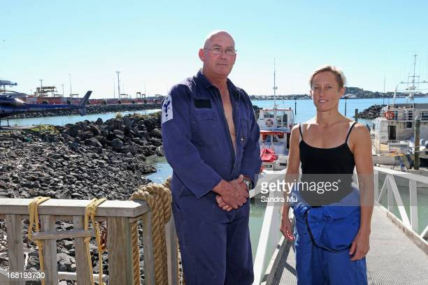Pilot Peter Maloney and engineer Nina Heatley pose after being rescued from Waitemata Harbour after a helicopter crash on May 7 2013 in Auckland New...
