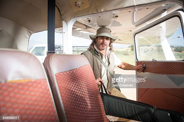Pilot putting bag into plane, Wellington, Western Cape, South Africa