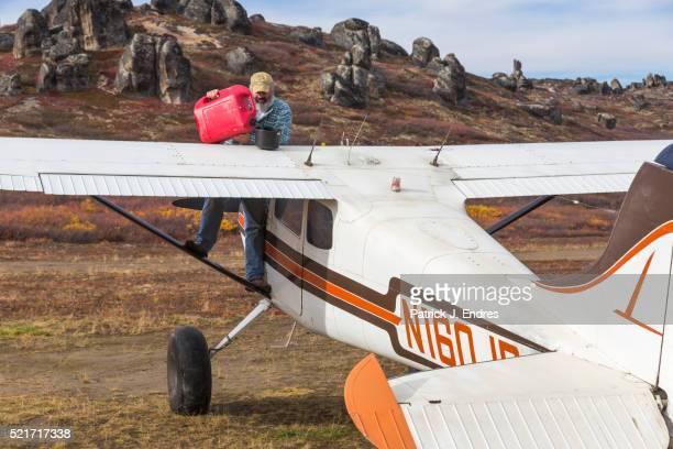 Pilot refuels bush plane