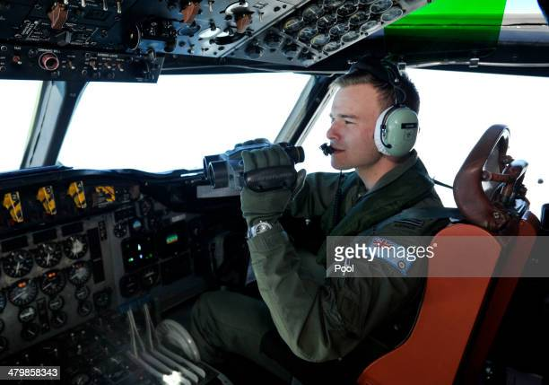 Pilot Russell Adams searches from a Royal Australian Airforce AP3C Orion from Pearce Airforce Base during a search mission for possible MH370 debris...