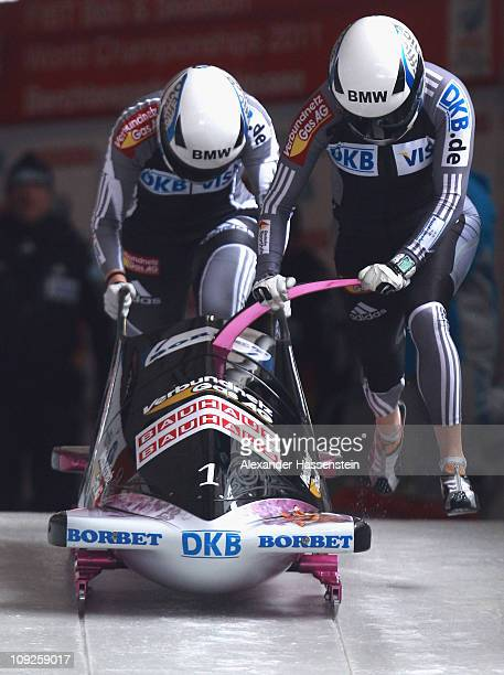 Pilot Sandra Kiriasis and Berit Wiacker of Team Germany 1 starts at the second run of the women's Bobsleigh World Championship on February 18 2011 in...