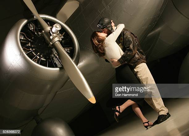 pilot saying goodbye - leg kissing stock photos and pictures