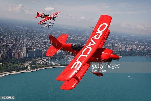 Pilot Sean Tucker and his son Eric fly their aircraft over Lake Michigan as they prepare for this weekend's Chicago Air and Water Show August 14,...